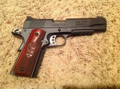 My deployment Kimber with my company logo on the grips. Kimber 1911