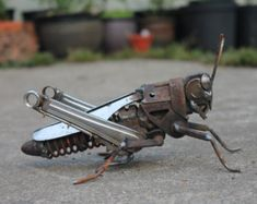 I made this frog from recycled scrap metal, including a vintage lock with a couple of keys and some stainless steel cutlery.  There are six