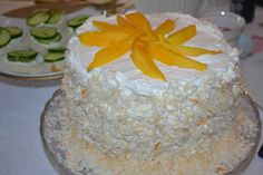 4 layer Coconut cake with Mango Filling. check out livebakelove for the latest recipe!! happy cooking!