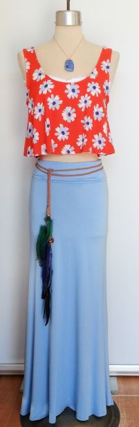 Floral crop top layered with a white bandeau and shown with a light blue long skirt. www.facebook.com/shopmudra