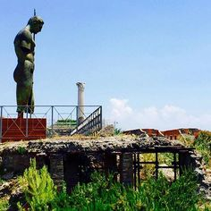 This majestic bronze sculpture by Igor Mitoraj titled Daedalus looks out from the ancient city of Pompeii to the Sorrento Peninsula. Mitoraj's incredible art echoes from a long lost civilization, to highlight human imperfection and raise awareness to the damage inflicted on ancient art.