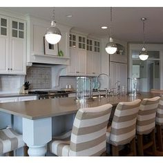 Spring Parade Home: I actually really like the tan countertops {quartz?} and there's those striped chairs I love!