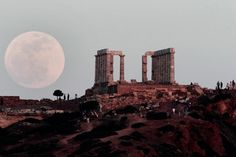 See Lord Byron's graffiti here! Pink moon behind the Temple of Poseidon in Cape Sounion, Greece