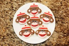 Sock Monkey Cookies by DeliciousDozen on Etsy, $30.00... (decided to create a board for it..since i <3 the sock monkey soooo much!!!)