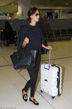 Klim dons a pair of chic loafers as she jets back to Indonesia Love the look: She showed off her runway legs in a pair of tapered black pants, which she .Love the look: She showed off her runway legs in a pair of tapered black pants, which she . Airport Travel Outfits, Travel Outfit Spring, Airport Style, Airport Attire, Airport Chic, Comfy Airport Outfit, Travel Chic, Travel Wear, Travel Style