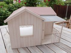 Dollhouse OOAK shabby chic in 1:12 scale with a little porch.  Size: L 13,38 x W 12,95 x H 9,25 inch or L 34 x W 33 x H 23,5 cm  Smallest room