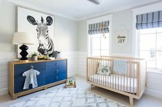 Tan and blue boy nursery features shiplap lower walls accenting light gray upper walls painted Behr Silver Drop.