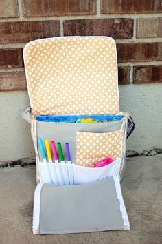 """This sewing tutorial is based on a messenger bag thatAshley of """"Mommy by Day Crafter by Night"""" designed. Renae of """"Hillmade"""" re-worked the bag and came up with a"""