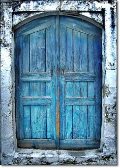 Blue door on old building in Crete, Greece.  Photo by Eleanna Kounoupa.