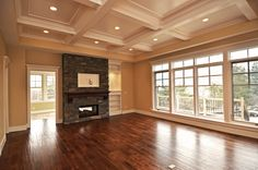Massive living room with double sided stone fireplace, hardwood floors and large #windows