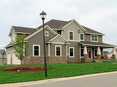LDK Home Exterior with end-load garage and large front porch. This home features James Hardie siding.