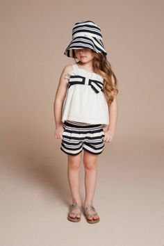 | Hucklebones | Giant Bow Sun Top $70.95; Candy Stripe Tailored Shorts $73.43; Candy Stripe Sunhat$51.15