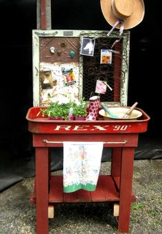 Here is an example of a red wagon used a garden potting stand.