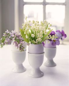 Make your Easter table bloom with tiny flower arrangements inside hollowed-out eggshells. Break an egg at the top of its shell, drain the contents, and carefully rinse out the inside. Next, fill the empty shell with room-temperature water and place it in an eggcup for stability. Finally, insert small cuttings of your favorite blossoms (we used lilacs, lily of the valley, and violas).
