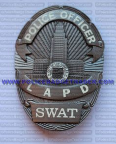 LAPD Los Angeles Police (Series 6) Police Officer - SWAT badge. Attachment: Rear pin and roller. Hallmark: Reevas Co. inc Longwood FL. 1968. Available at www.policebadgetrader.com