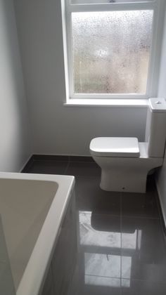 Shiny Porcelain Floor Tiles in an installation project by UK Bathroom Guru