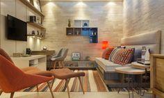 Com apenas 14m² , o espaço do hóspede, de Geisa Hartmann, tem como trunfo o revestimento cimentício que imita o mármore travertino, mas com custo menor Divulgação