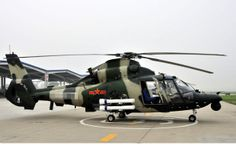"Chinese Harbin Z-9.Originally built from kit of French SA Dauphin (Dolphin),then reverse engineered & produced same way as Chinese regularly done with Russian supplied equipment.Basic version can carry up to 10 soldiers.Attack version.Z-9W (WZ-9) optical roof & hard points on flanks.Version of Z-9W has FLIR under nose.Can carry 23mm gun pod or 12.7mm anti-tank missiles HJ-8 (max 8),57mm rocket pods or 90mm ​​& air-to-air missiles TY-90 infrared.Z-9C ""navalized"" Z-9 in Chinese navy."