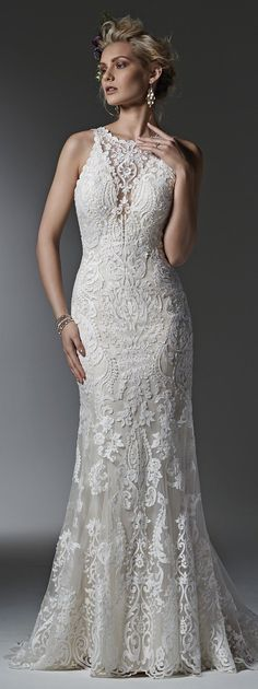 Sottero and Midgley - WINIFRED, Timeless and elegant, this lace sheath wedding dress features a modern illusion deep V halter neckline, a stunning, scalloped plunging back, and illusion straps. Finished with covered buttons over zipper closure.