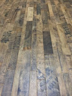 Coopersmark Whiskey Barrel Flooring. Our Coopersmark Whiskey Barrel surface is made from the outside of the barrel – showcasing all the patina, cooper-stamps, and distillery markings. The sumptuous history and authenticity of this special material makes it the flooring of choice for whiskey aficionados everywhere.