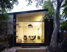 Haines House by Christopher Polly. I don't get the outhouse concept but I REALLY want the pocket doors between the outdoor and indoor living space.  Would be PERFECT for my family room.