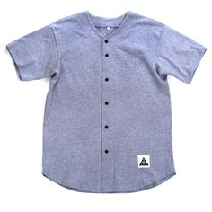 American-made, classic grey baseball jersey constructed from sturdy thick-knit jersey, featuring button down front and short sleeves. - Poly-Cotton (50% Polyester / 50% Cotton) construction - 6-button