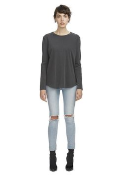 The Avoca Longsleeve Tee in Charcoal by C&M CAMILLA AND MARC is a casual cotton jersey tee designed with exposed raw edge seams.  Relaxed fit round hem Raw edge seams  Standard in sizing. Our model is 175cm/5' 9'' tall and wears a size small, 8 or 26.