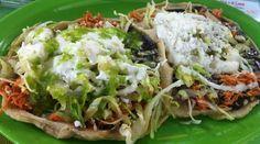 Mexican sope de pollo with beans, lettuce, sour cream, cheese & salsa verde
