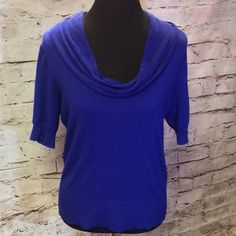 STUNNING COWL NECK SWEATER BY DKNY This Royal blue beauty is perfect for the upcoming holidays as well as for work or casual with jeans. Short sleeve and cowl neck DKNY Sweaters Cowl & Turtlenecks