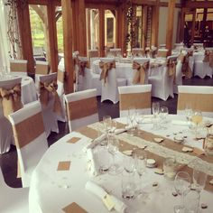 Rustic wedding at Peover Golf Club. Burlap  sashes with pearl brooch, Burlap and lace table runners, white tablecloths and chair sashes. Create with www.cvlinens.com at super low pricing.