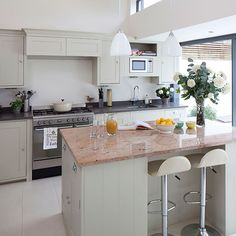 Want modern kitchen decorating ideas? Take a look at this neutral kitchen with island breakfast bar from Beautiful Kitchens magazine for inspiration. Find more kitchen decorating and shopping ideas at housetohome.co.uk
