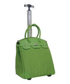 Poshly pack all those accessories aboard with this chic travel tote. Designed with sturdy trolley handle and in-line blade wheels, it's easy to maneuver through busy airports and makes an ideal carry-on. A rear accessory compartment and internal laptop pocket offer a few-first class luxuries that make jet-setting with this bag all the more enjoyable. 16'' W x 18'' H x 9'' D