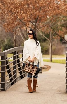 cute & little blog   petite fashion   white cable knit poncho, distressed jeans, bare traps adaire pom pom fur boots   winter outfit