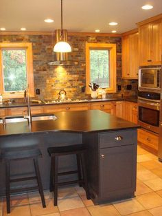 natural cherry, slate, and soaptone contemporary kitchen remodel