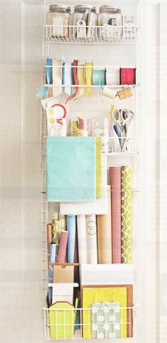 This over-the-door organizer has room for everything you might need for gift wrapping. Cute containers and jars keep labels, stickers, and tape organized too.