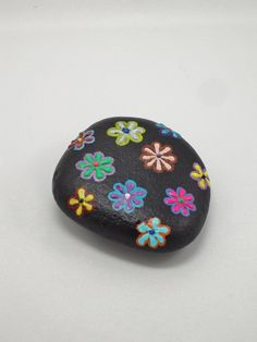 Painted Stone Flowers Painted on Stone Stone by ThePaintedCanary ...BTW,Please Check this out: http://artcaffeine.imobileappsys.com