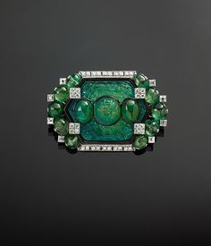 Brooch with Carved Emeralds and Diamonds by Cartier, circa 1925, modified by…