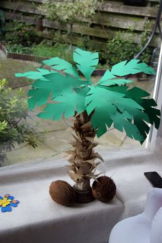 Small paper palm tree with real coconuts. Luau Centerpieces, Luau Decorations, School Decorations, Paper Palm Tree, Palm Trees, Monkey Birthday Parties, Diy Birthday, Birthday Event Ideas, Lion King Birthday