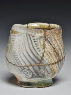 """Dick Lehman's cup. At the end of Lehman's article, Itinerate Wood Firer, in the September 2014 issue of Ceramics Monthly Lehman says, """"I've begun working at Kintsugi (gold repair). This helps me to honor the beauty, enhance the value, and accept what might otherwise seem less successful than I expected."""" To read Lehman's article, visit http://ceramicartsdaily.org/ceramics-monthly/ceramics-monthly-september-2014/ to log in to the online version (subscribers only) or purchase a PDF download."""