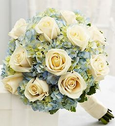Blue and White Bridesmaid Bouquet- 12 white roses, blue hydrangea and variegated pittosporum $90.00
