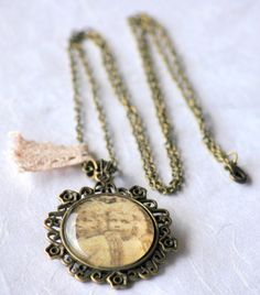 Round Cameo Pendant Vintage Angels Antique Bronze Victorian Jewelry Glass Cameo Necklace Filigree Bronze Long ChainBeatiful Long Pendant Glass Cameo with Filigree in Antique Brass with pic of Vintage Angels.Measures 40 x 40 mm. Glass Dome 30 x 30 mm.Available to choose different lengths of...