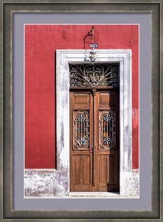 Sold a framed print of Wood and Wrought Iron Doorway in Merida to a buyer from Southington, CT