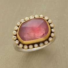 PINK COSMOS RING -- Irregular facets span a luminous pink sapphire universe rimmed in matte 22kt gold and glistening with starry diamonds. Sterling silver backing and band. Handmade in USA by Ananda Khalsa.