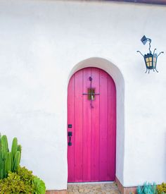 I love everything about this Santa Barbara home: Spanish revival architecture, the #pink door and the plants used! // Dwell.com
