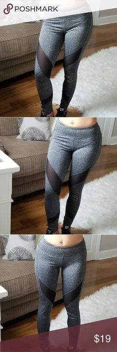 """KORAT Heather Gray Black Mesh Leggings 79% Polyester, 16% Spandex, 5% Nylon ▫️Surprisingly comfortable, stretchy AND thick, these *squat-approved* leggings feature linear black mesh panels, a hidden pocket at hip for small items (house key, gym keytag, money, etc.) a solid back and heather gray moisture wicking fabric  ▫️Size small to medium Modeling size small. My measurements are 5'1, 26"""" waist, 40"""" hips Size small measures 35"""" length, 24"""" waist, 27"""" inseam Bella Edge Pants Leggings"""