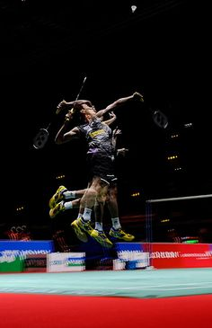 The best male singles player in the world, Lee Chong Wei of Malaysia, leaps to play a smash in his first-round match. - Tom Jenkins
