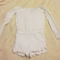 Perfect off the shoulder romper! Perfect summer romper! Goes off the shoulder and has lace down the arms. It's a small but I shrunk it a bit in the wash so fits an xs now- I have a big booty to it fits but just too tight Pants Jumpsuits & Rompers