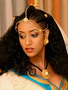 Ethiopian actress and film director Amleset Muchie wearing traditional cloth and jewelry