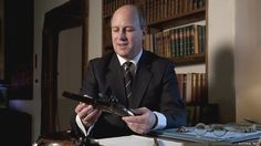 Randolph Churchill, Winston's great-grandson, with a pair of duelling pistols belonging to Churchill's 17th century ancestor John, 1st Duke of Marlborough, and builder of Blenheim Palace.