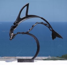 Gorgeous dolphin sculpture made from scrap metal that was once used as agricultural equipment. Dolphin Art, French Countryside, Wall Sculptures, Welding, Metal Art, Dolphins, Scrap, Gadget, Florida